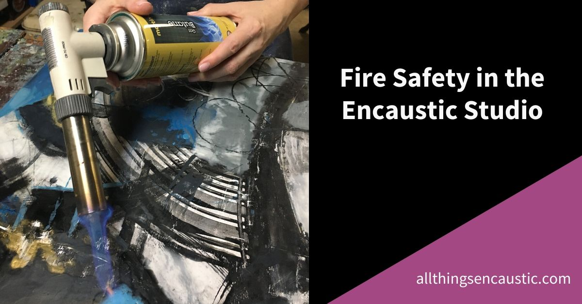 Fire Safety in the Encaustic Studio - Hands using a butane torch to fuse a painting